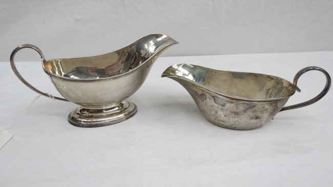 A silver sauce boat on stepped base, marked Birmingham