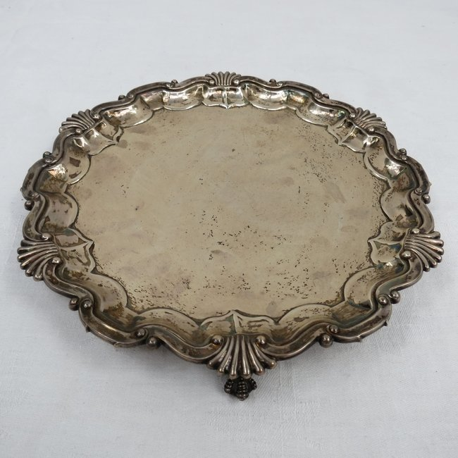 A small silver salver with shell and piecrust rim, mark