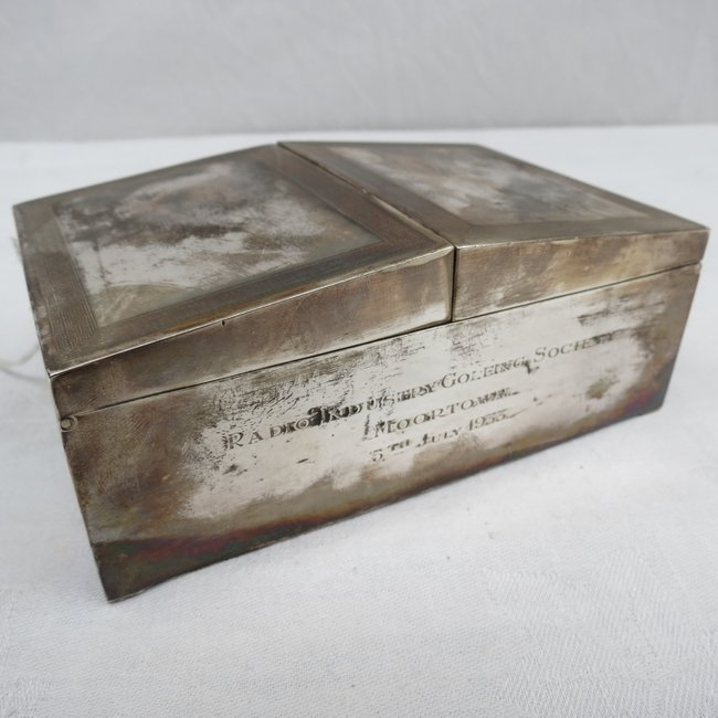 A silver table cigarette box with double lid and key pa