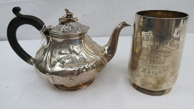 An HM silver Georgian teapot with repousse decoration,