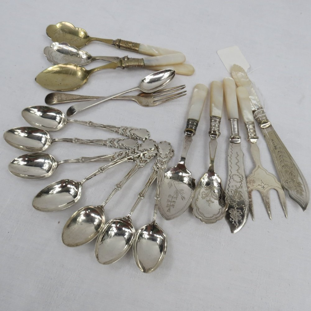 Seven HM silver golf themed teaspoons, marked Birmingha