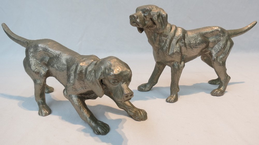 A pair of cast metal figures of hunting