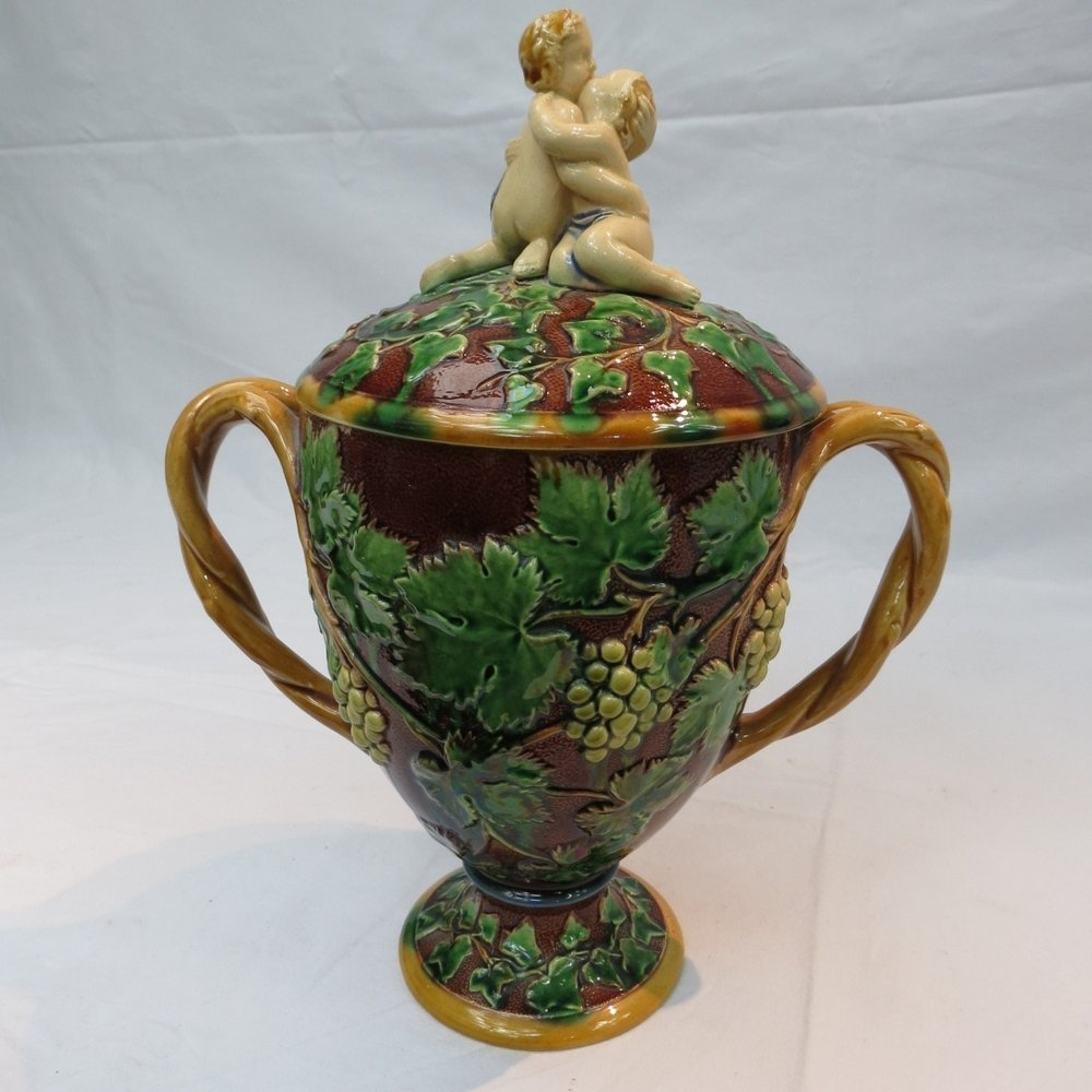 A mid 19thC. majolica twin handled cup a