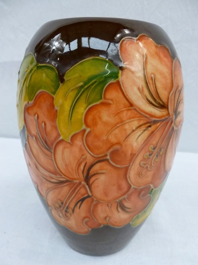 A Moorcroft vase, decorated with hibiscu