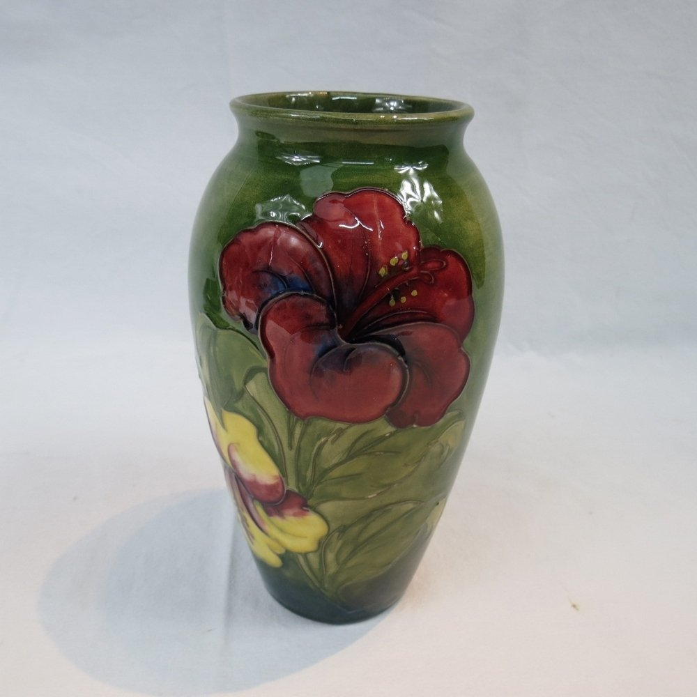 A Moorcroft Hibiscus vase with green gro