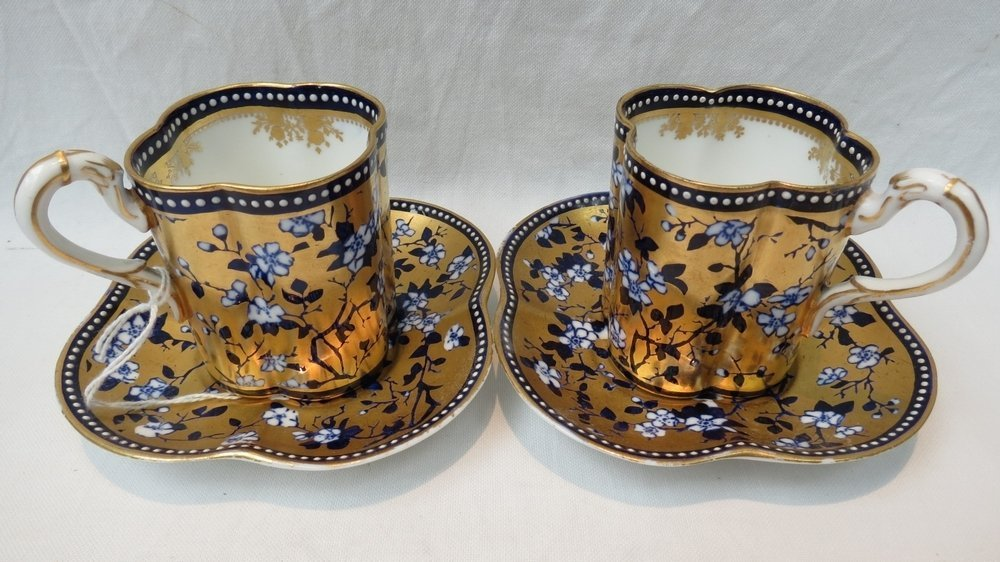 A pair of early 20thC. Coalport cabinet