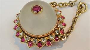 A shield pendant with cabachon quartz st