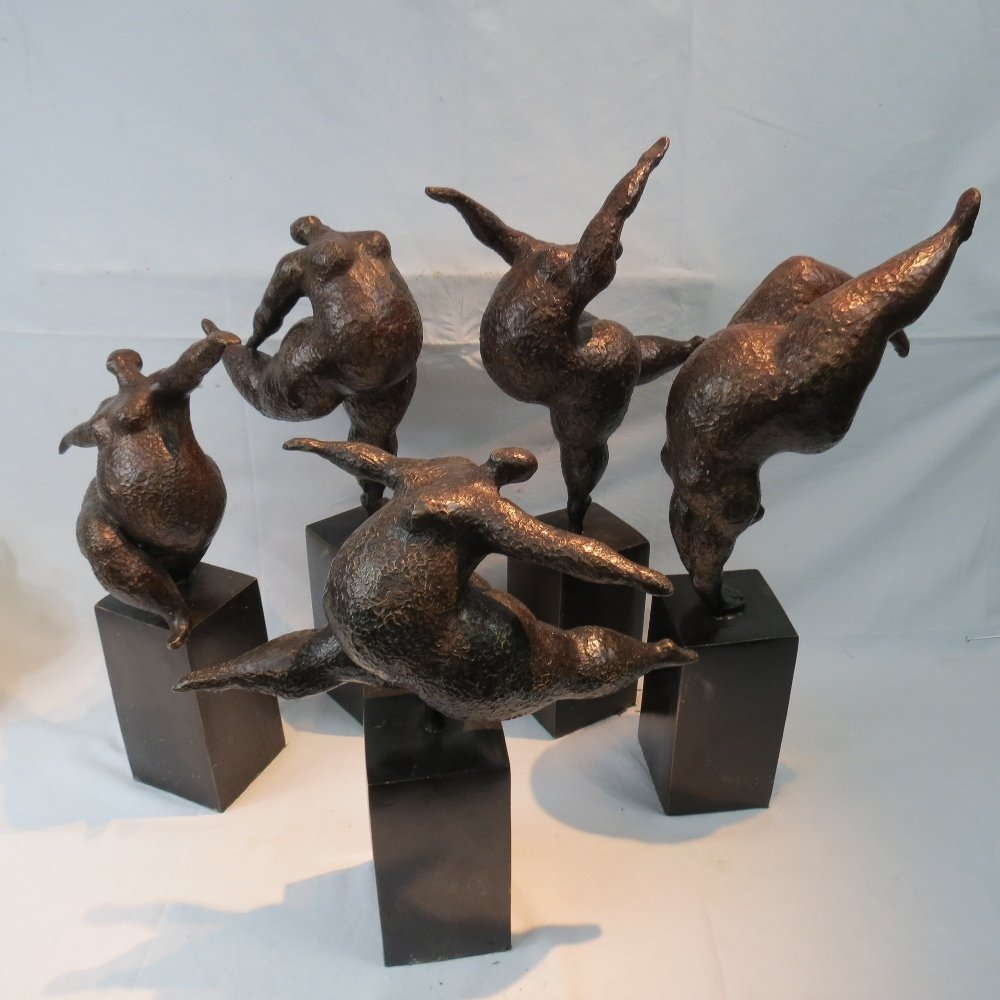 A 20thC group of bronzed dancers, the co