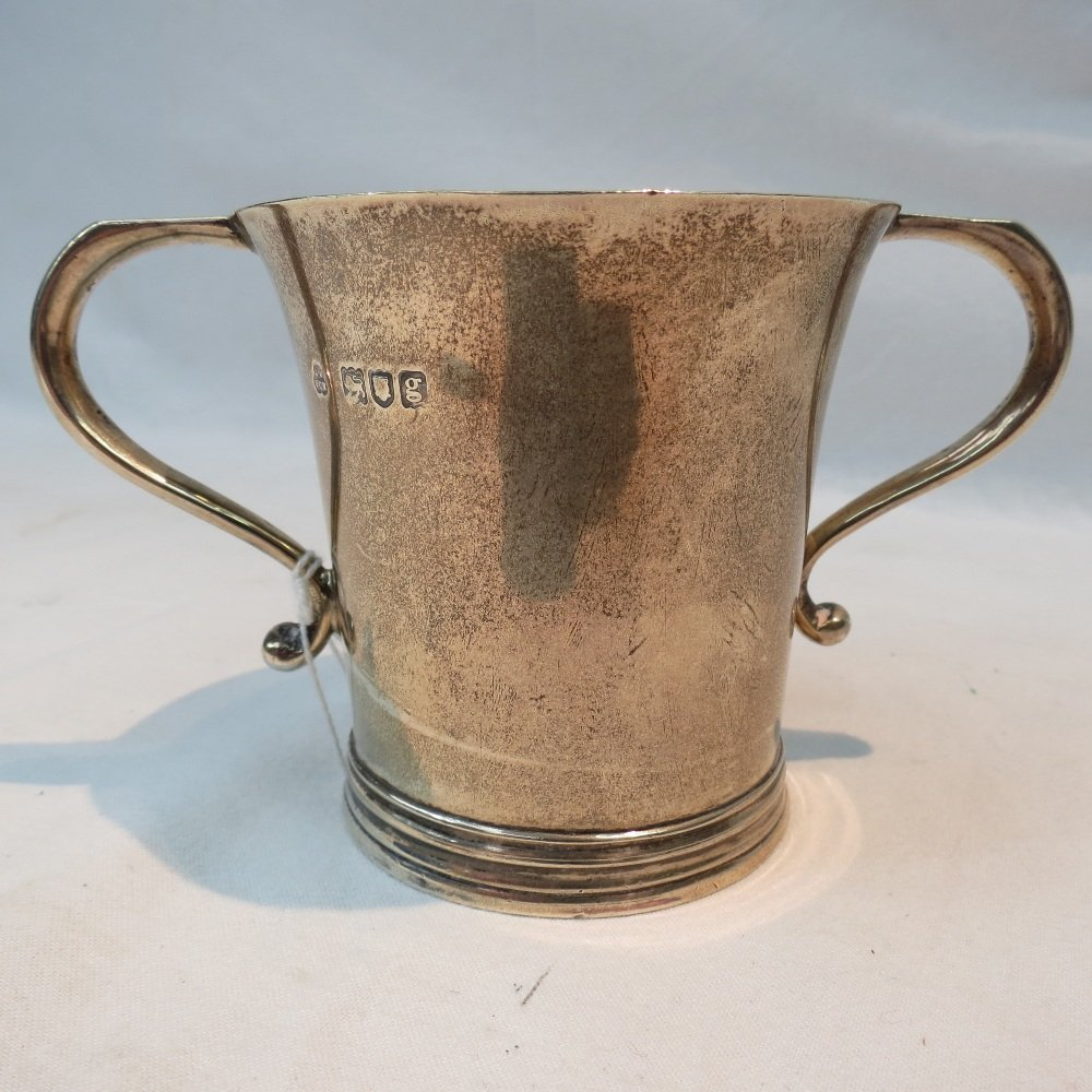 An HM silver two handled cup retailed by