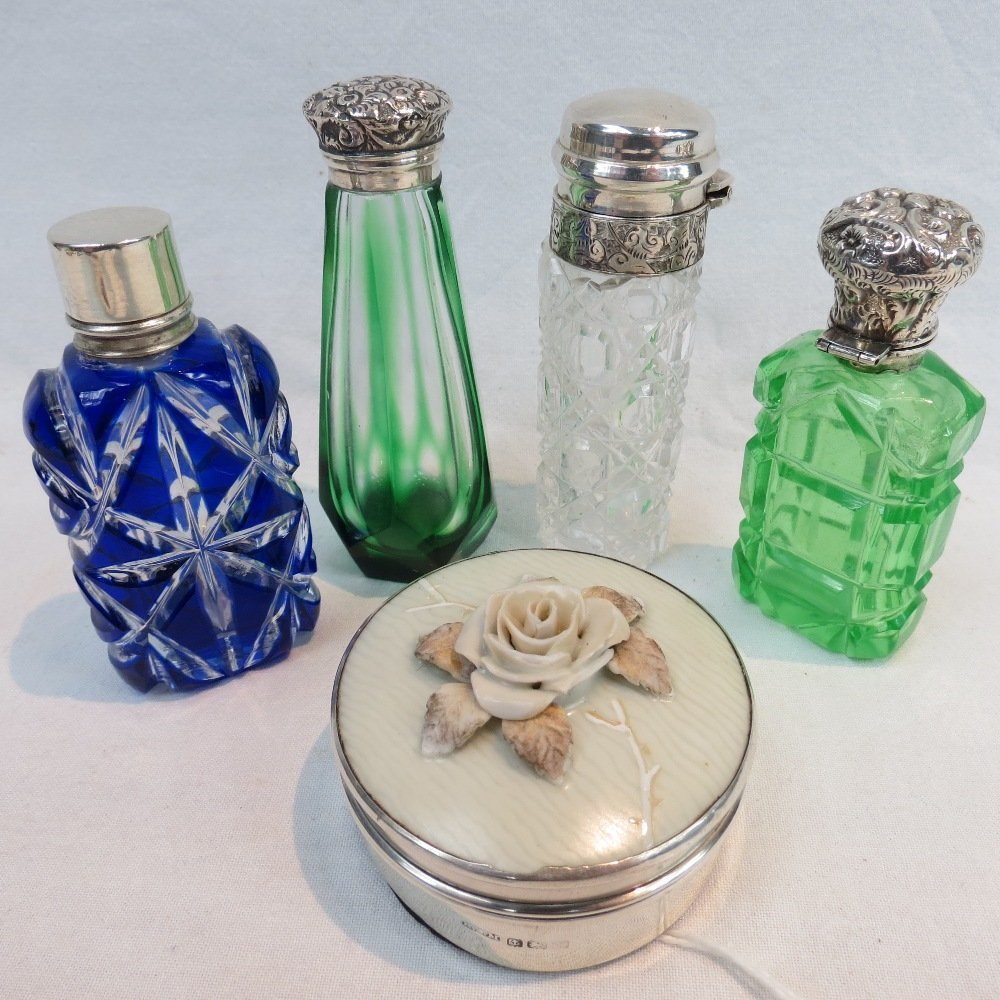 Four silver mounted cut glass scent bott