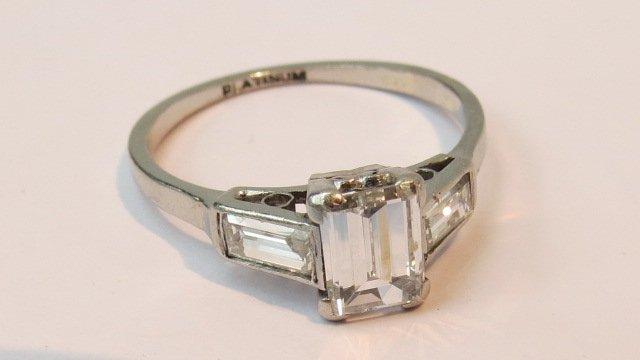 A single stone diamond ring. The trap cu