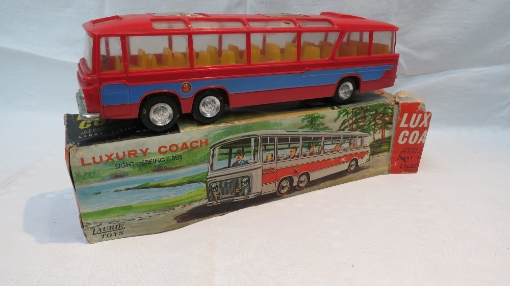 A Laurie Toys motor coach, red cast plas