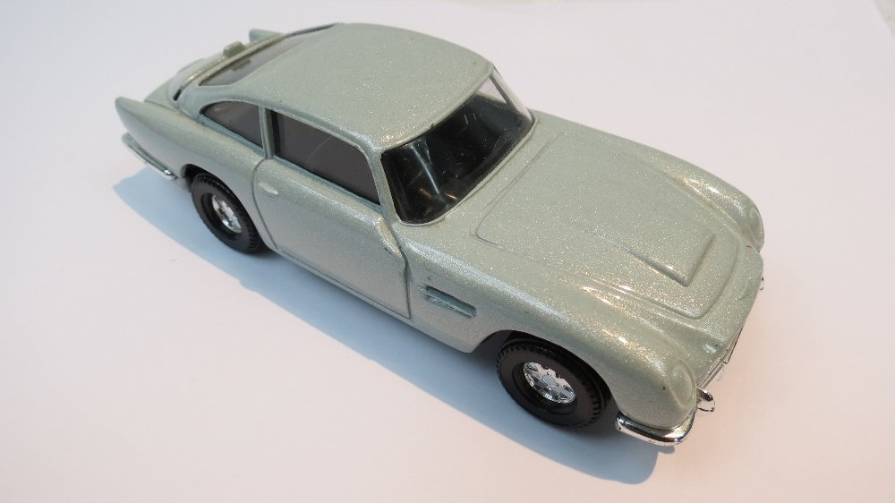 A Corgi Aston Martin DB5 finished in pea