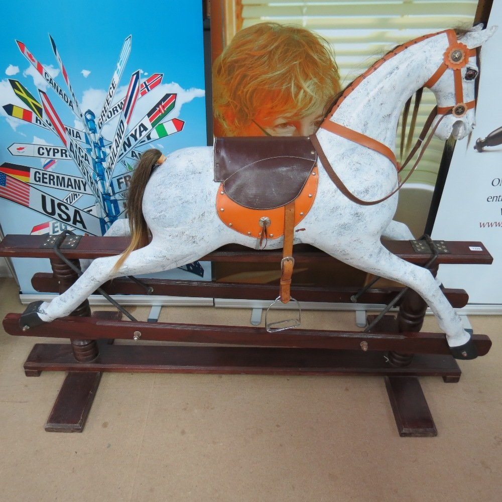 A 20thC rocking horse, dapple grey with