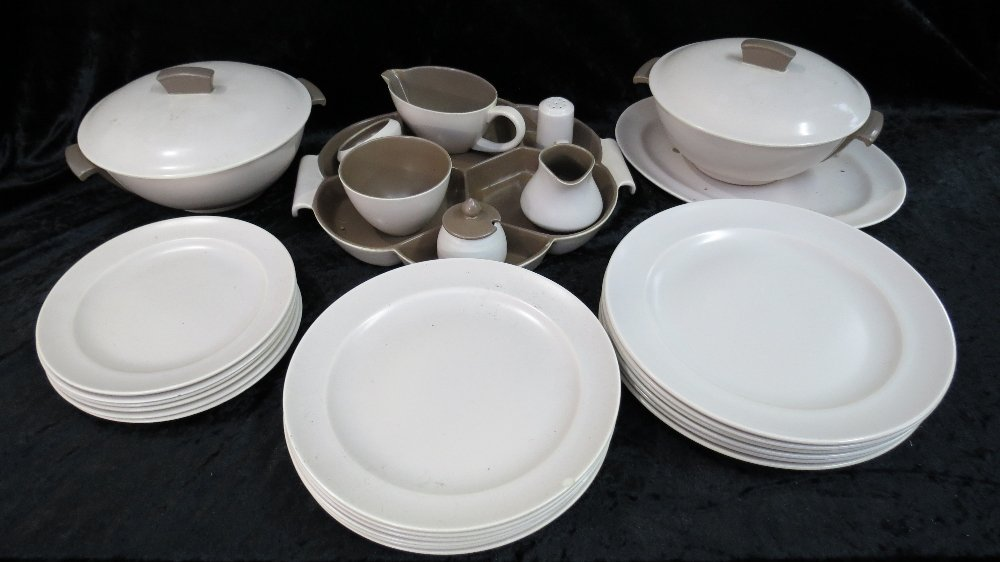 A Poole Pottery two tone dinner service of six place