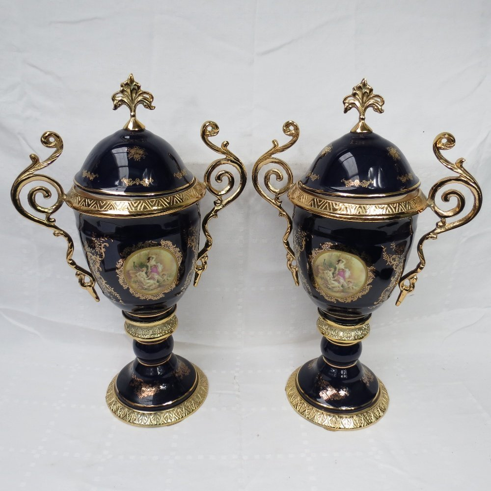 A pair of contemporary gilt metal mounted lidded vases,