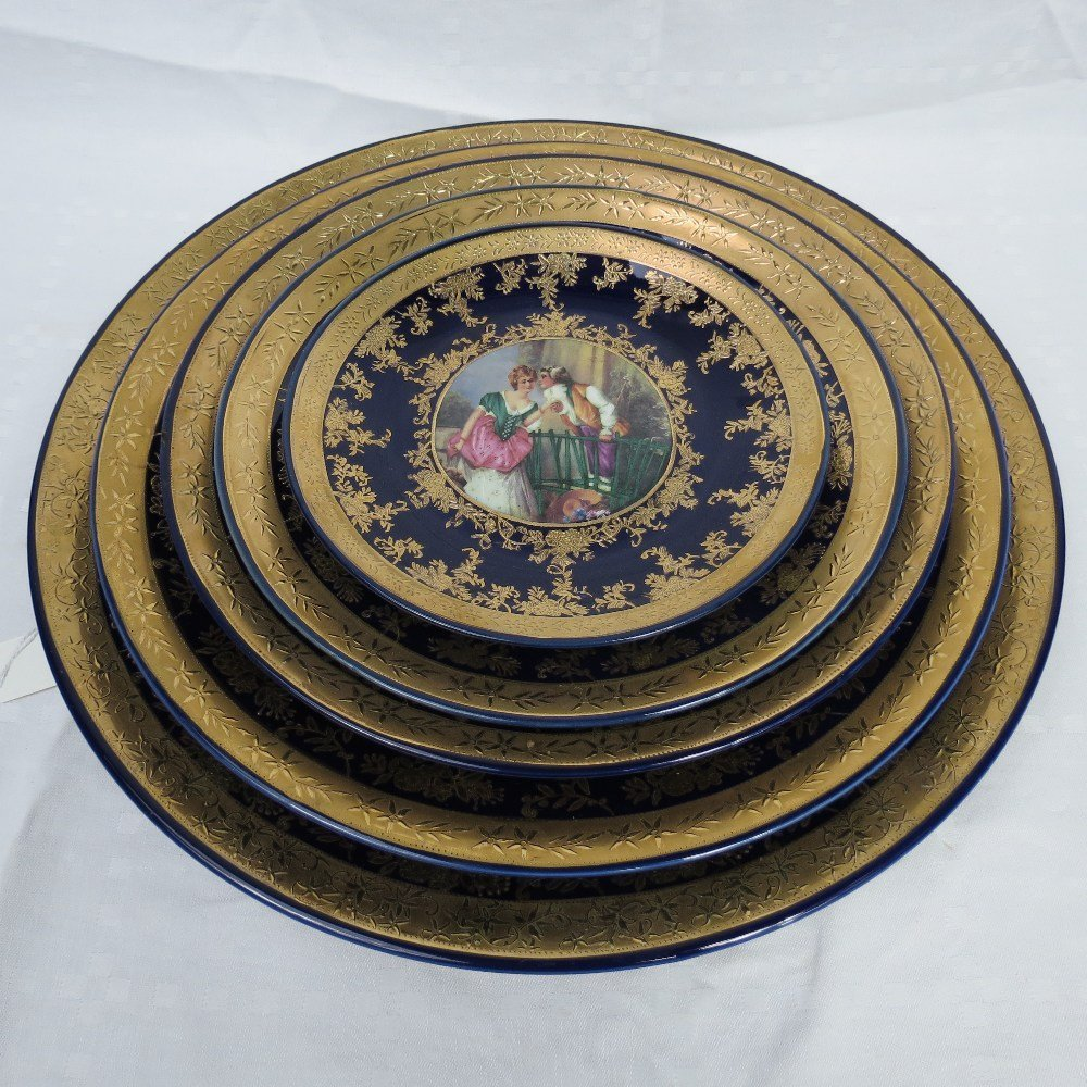 A set of five Viennese style graduated wall plates, the