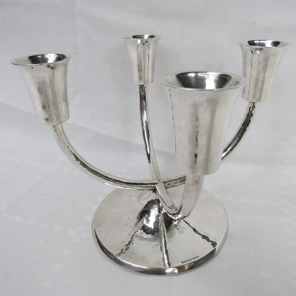 A German silver, (830 grade) four armed candelabrum