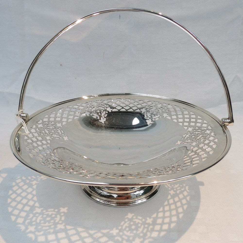 An HM silver cake basket with pierced and cut