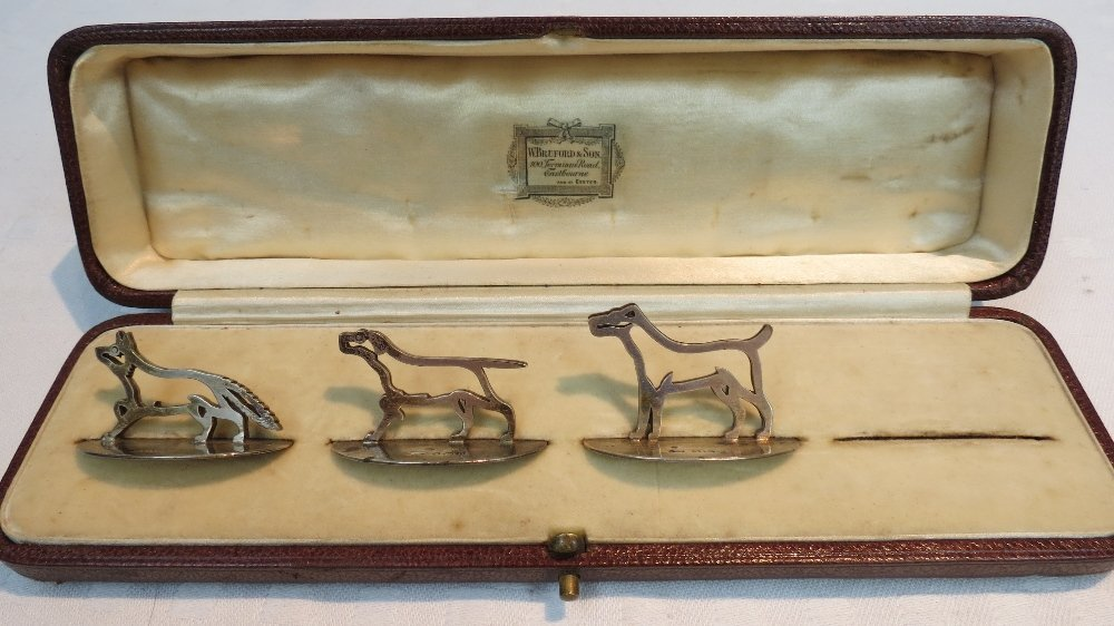 A set of menu card holders of a hunting theme,