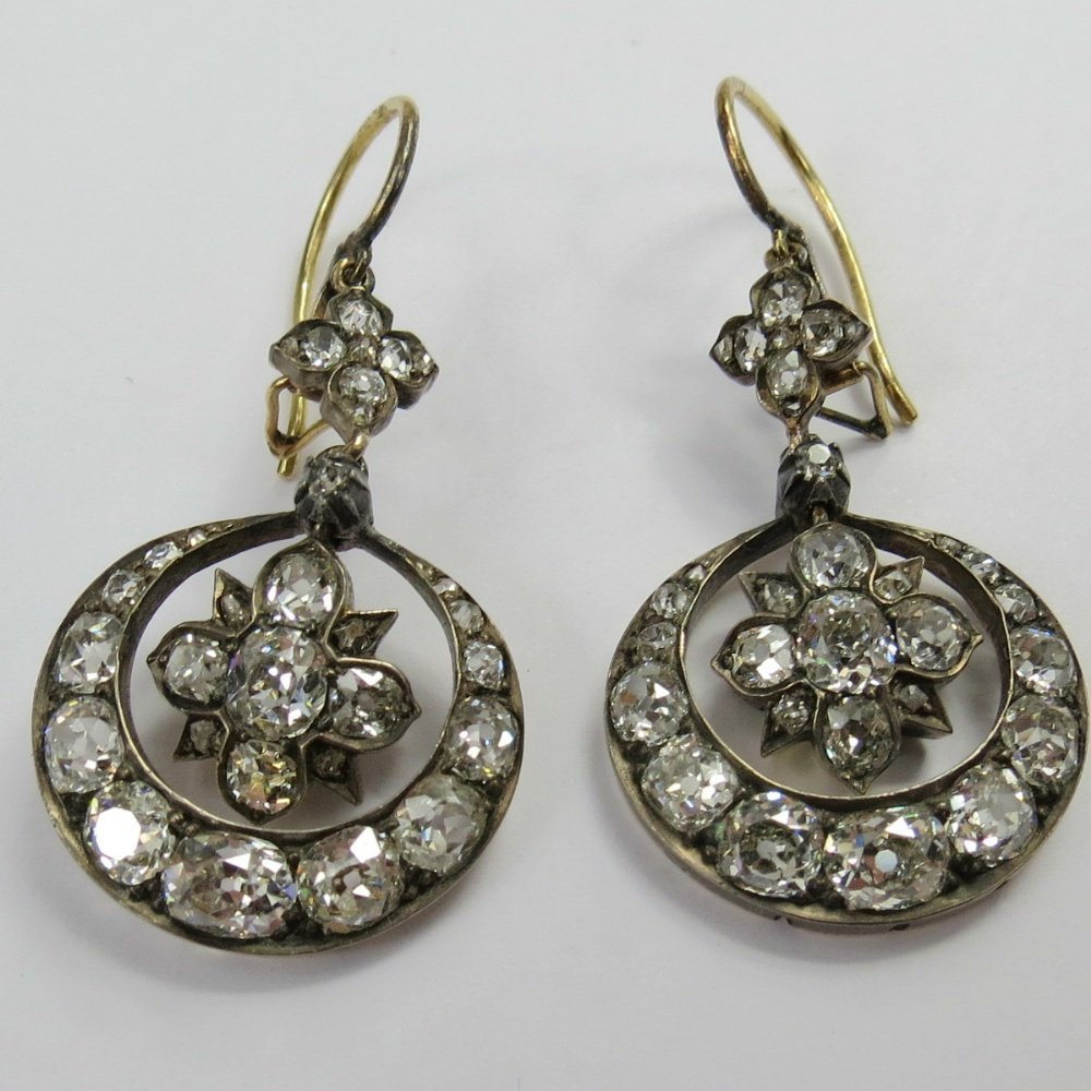 An impressive pair of crescent and star drop diamond