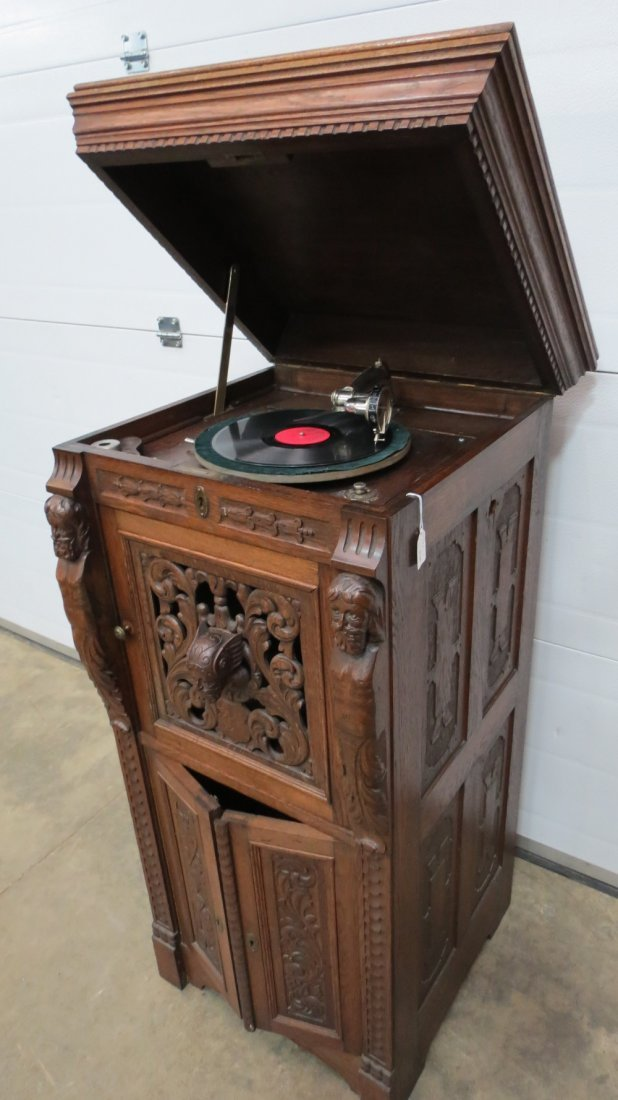 A carved oak Parlophon cabinet gramophone with a