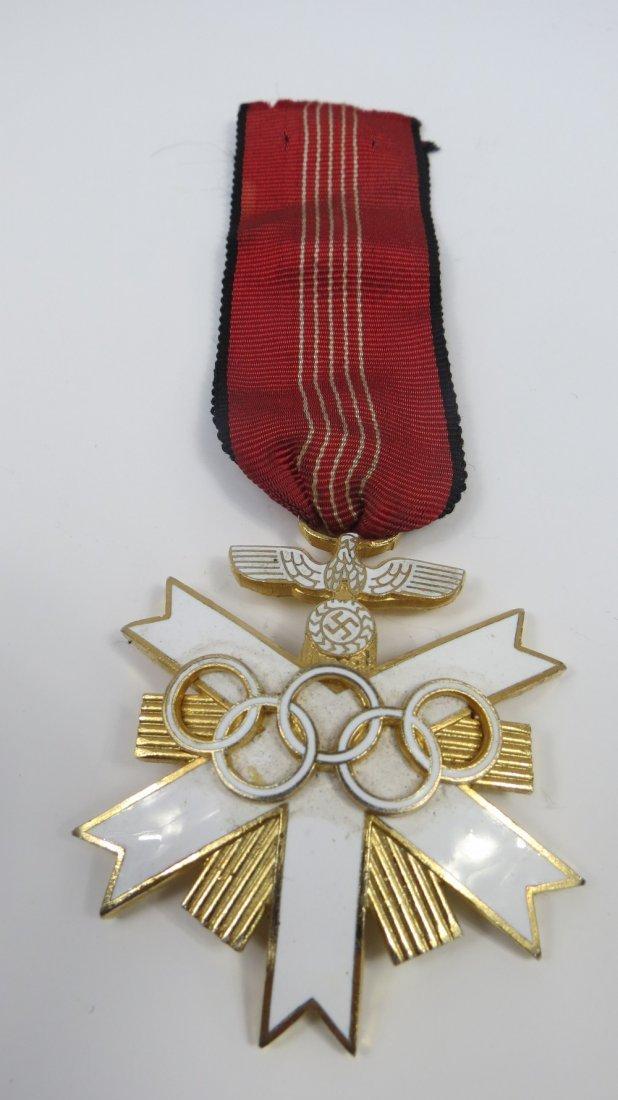 A German Olympic decoration, white enamelled gilt metal