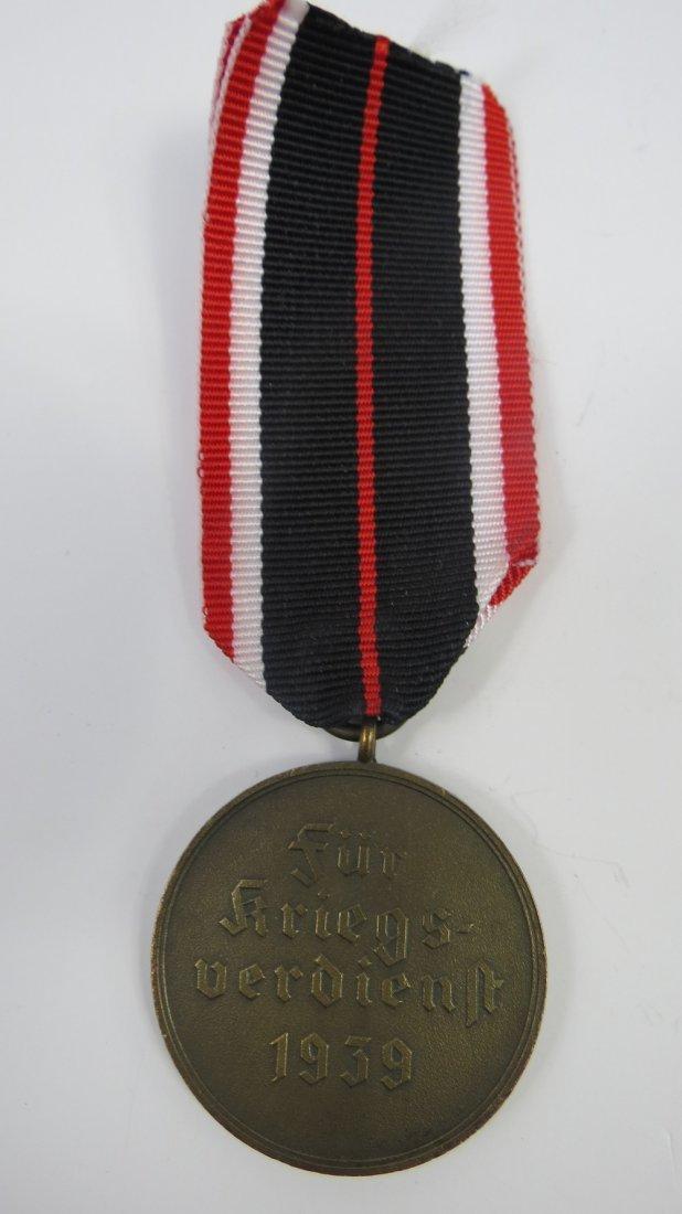 A WWII German war merit medal, circular bronze cast