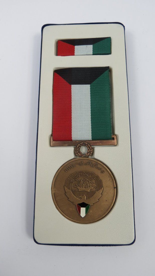 A Gulf war medal, together with ribbon, box and