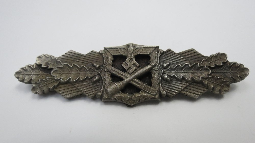 A Nazi army close combat clasp white metal with a