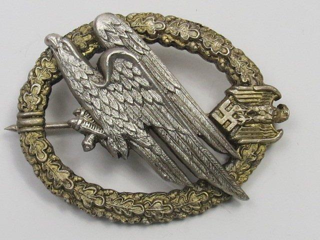 A Nazi Parachute Regiment badge, diving eagle on a gilt