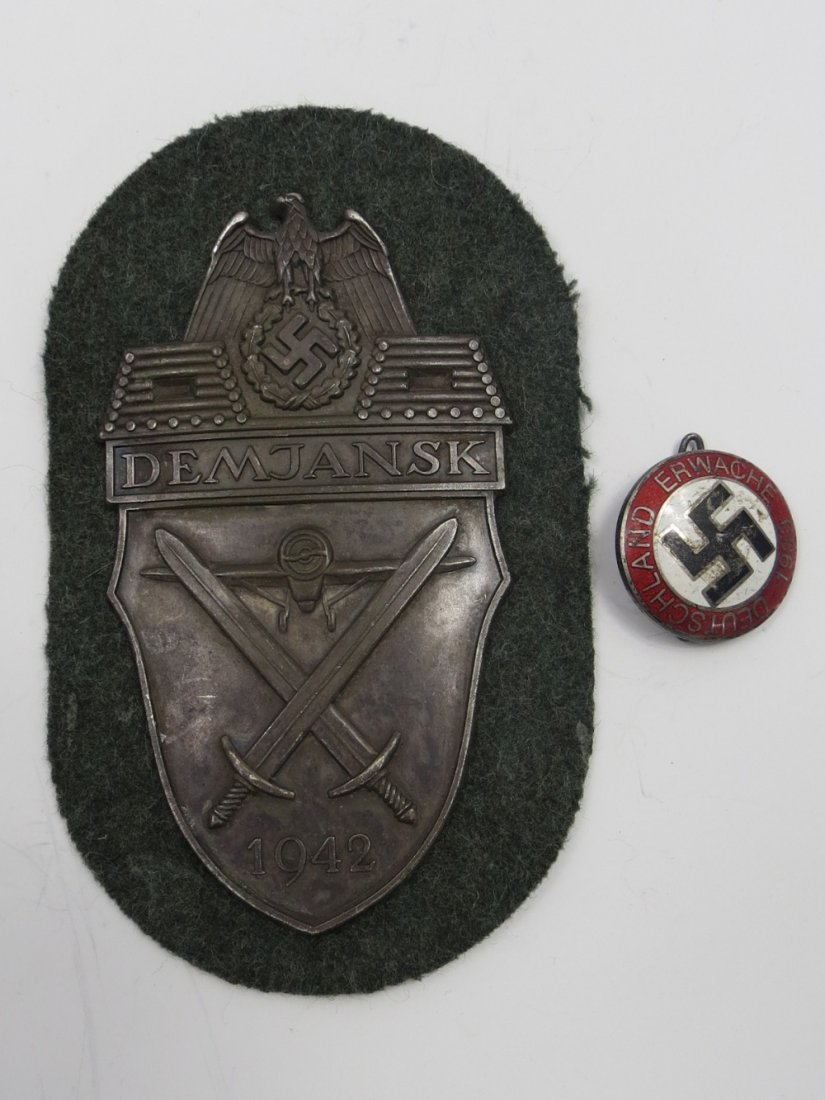 A Nazi Demjansk shield with an aircraft and crossed