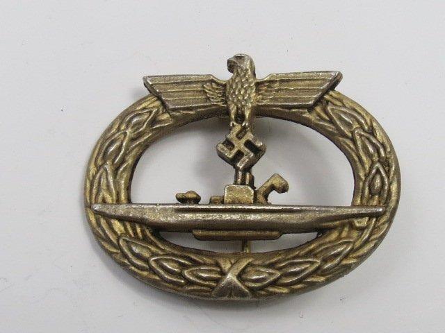A Nazi U boat badge, the vessel on an oval wreath. 4cm.