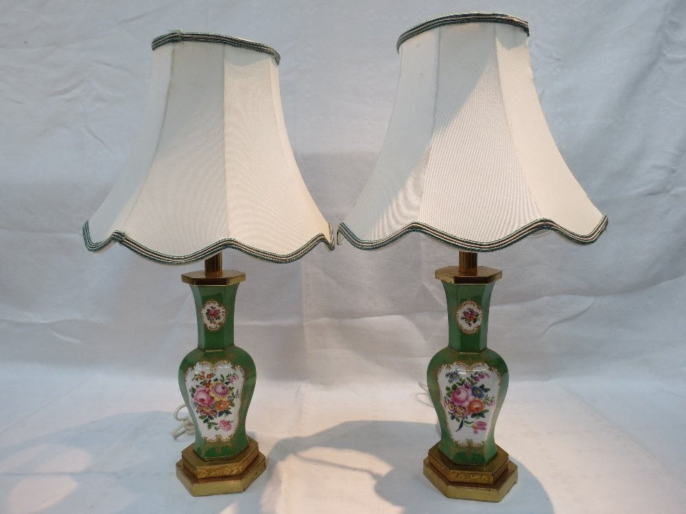 A pair of green glazed table lamps, of octagonal form