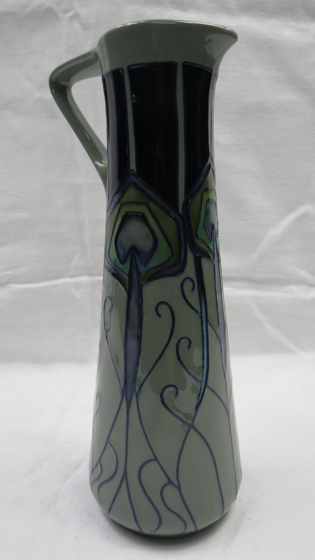A Moorcroft trial tall jug with peacock feather design,
