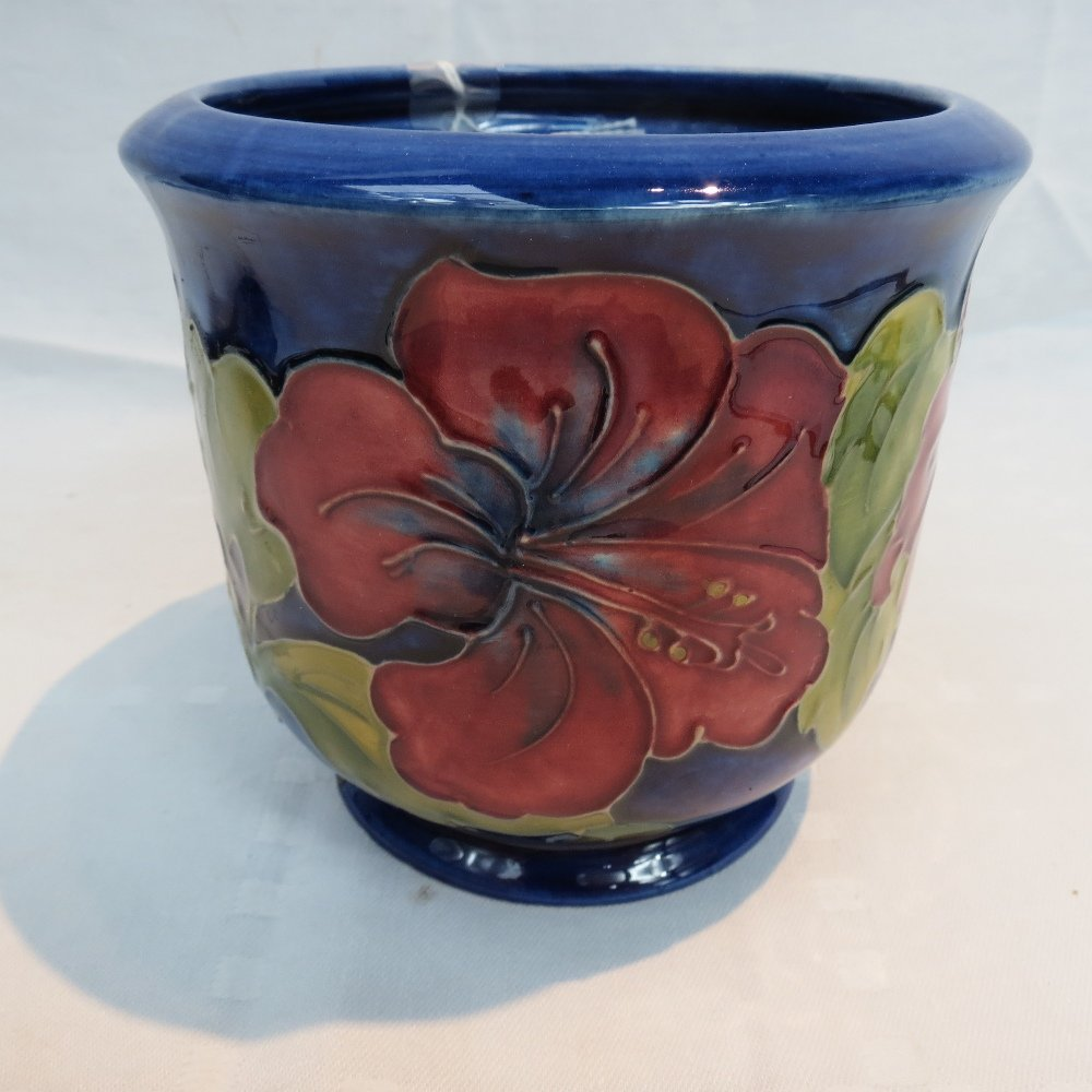 A Moorcroft jardiniere decorated with hibiscus design