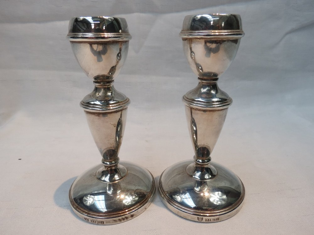 A pair of HM silver miniature candlesticks