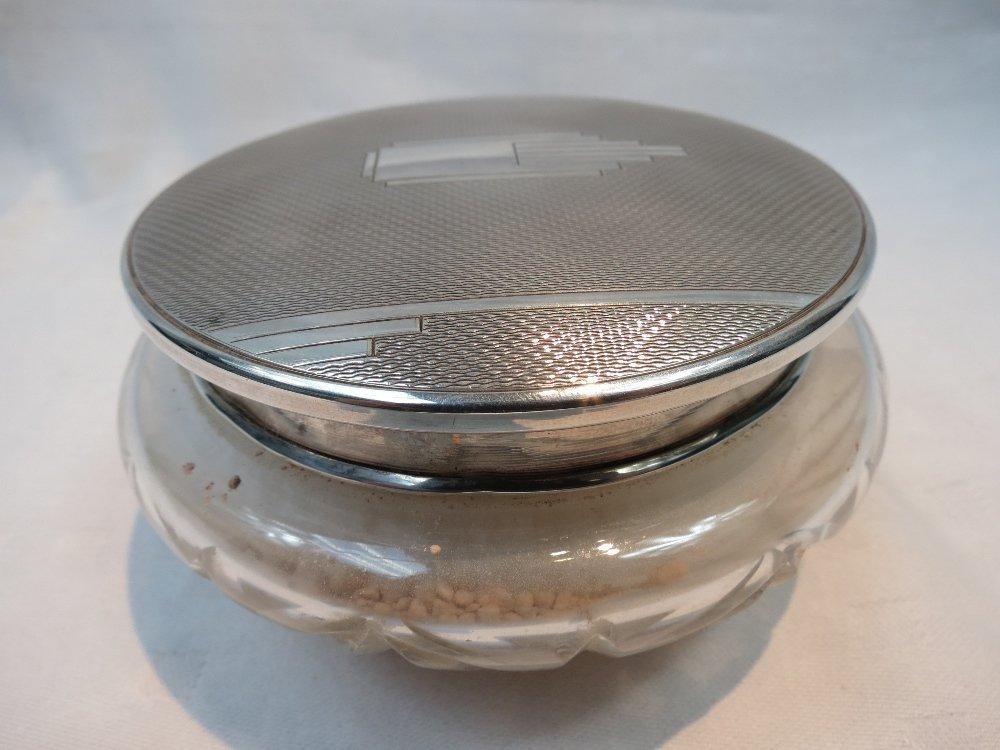 An HM silver mirror lidded art deco talcum powder cut