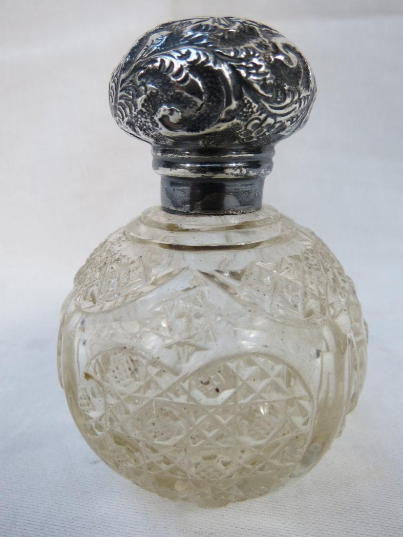 A late Victorian cut glass scent bottle