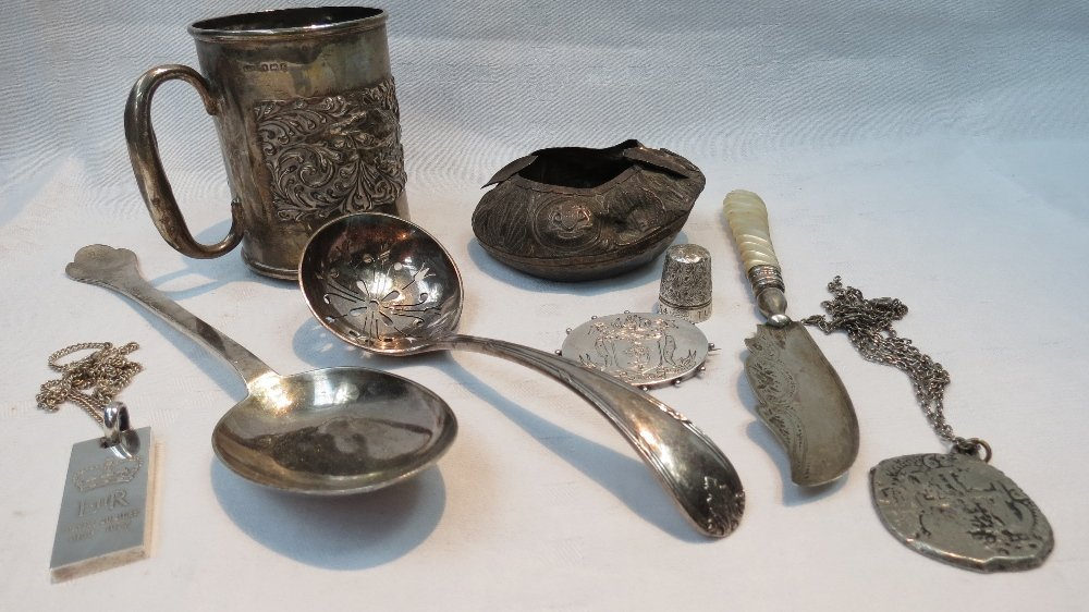 An HM silver serving spoon of trifoid design