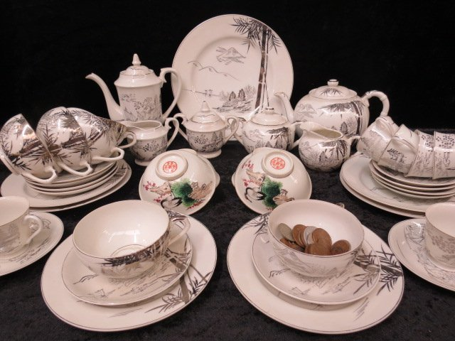 A Japanese eggshellware tea service, white with silver