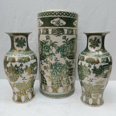 A pair of baluster shaped oriental vases, gilt