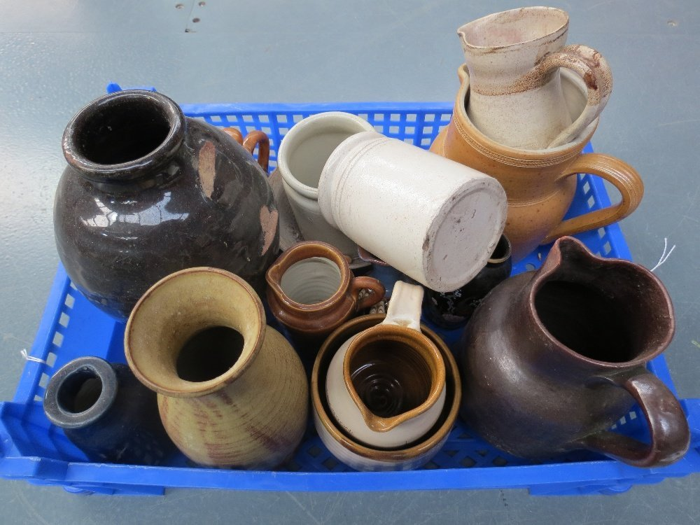 A small collection of studio and craft pottery jugs,