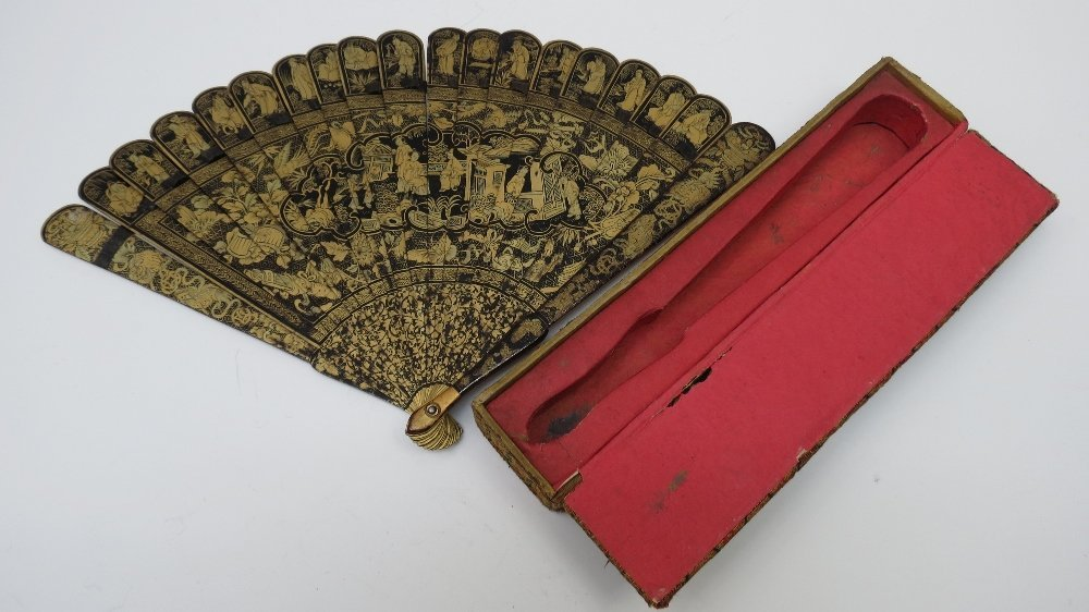 A Chinese gold and black lacquer brissee fan, with