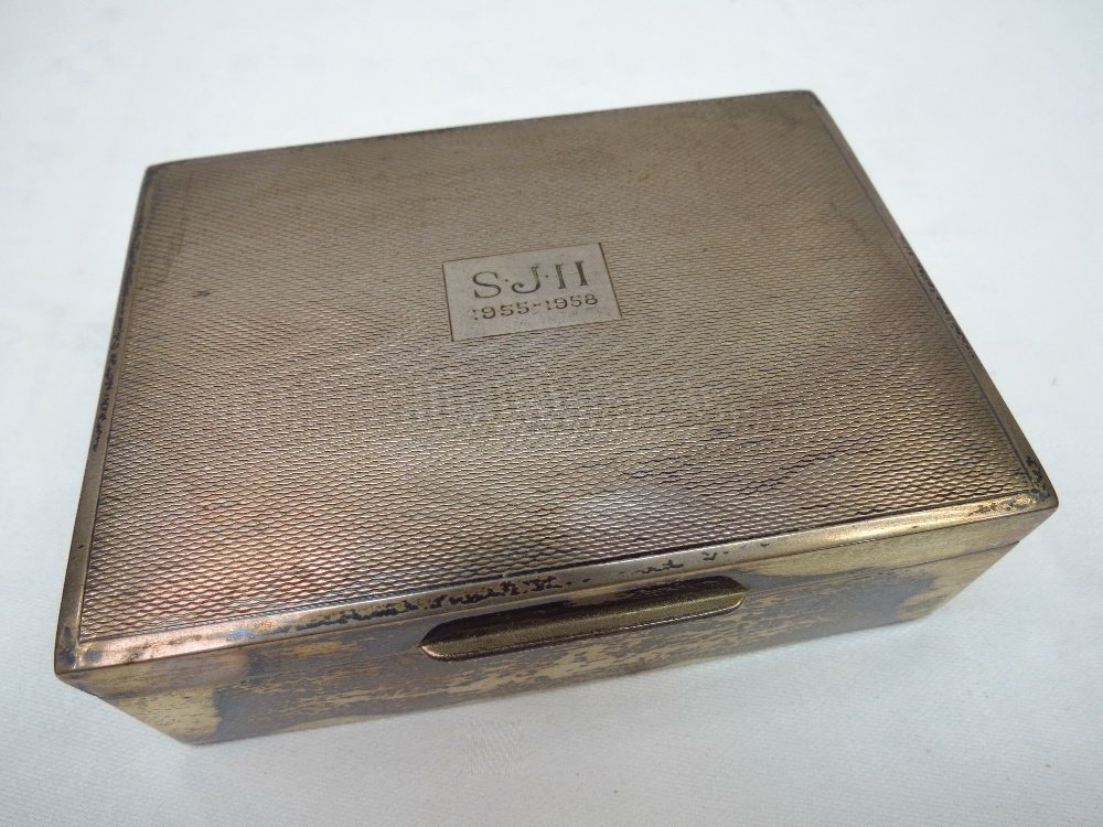 An HM silver engine turned cigarette box, marked