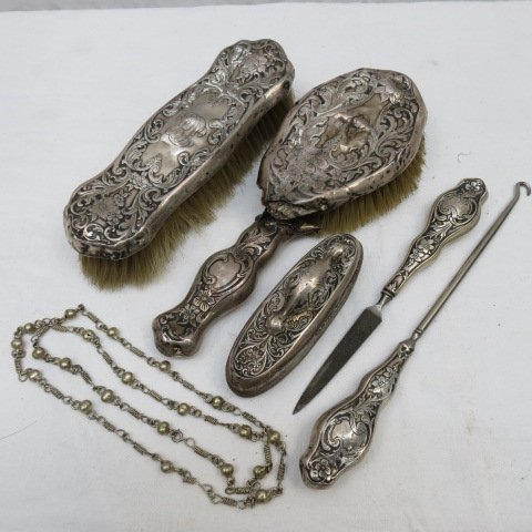 A sterling mounted dressing table set comprising