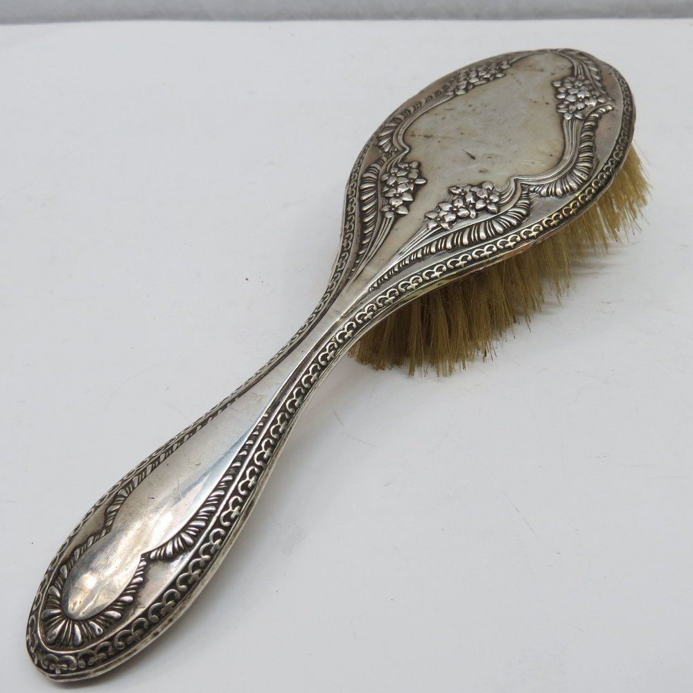 A silver mounted hairbrush, marked Chester, early 20th