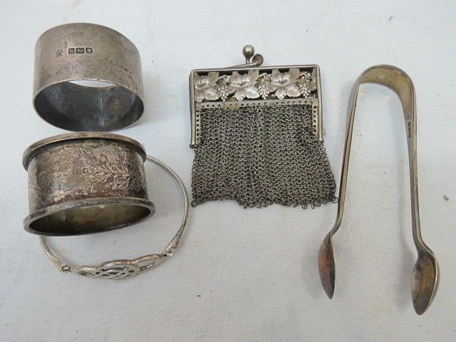 A small continental white metal mesh purse, the clasp