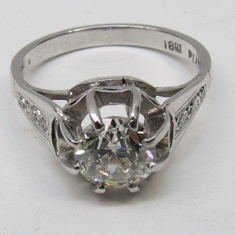 A single stone diamond ring. The old cut brilliant