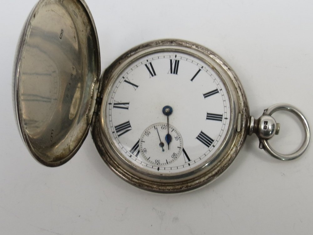 A silver full hunter pocket watch, key wind partially
